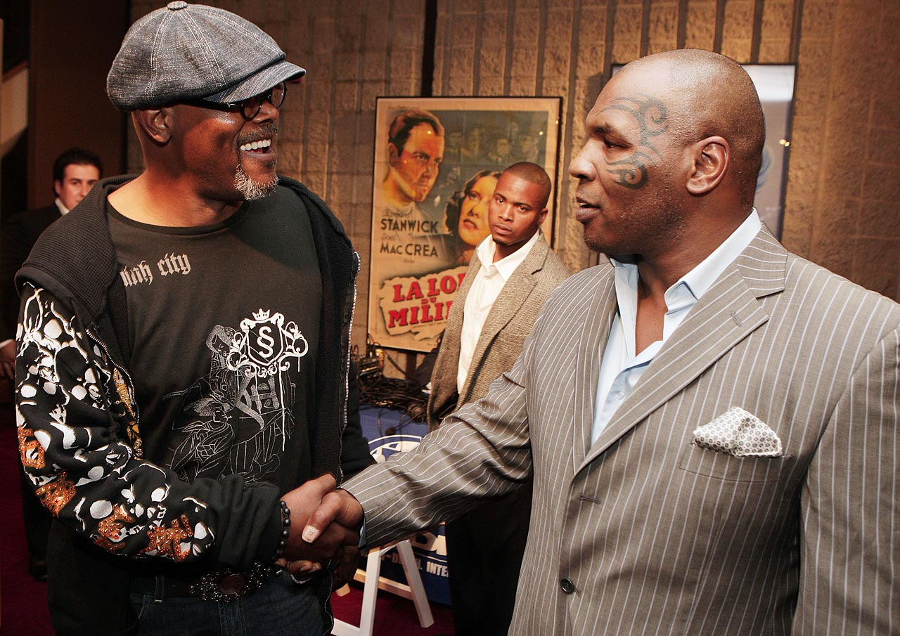 "Samuel L. Jackson shakes hands with Mike Tyson at the afterparty for the premiere of Yari Film's ""Resurrecting the Champ"" at the Academy Theater in Beverly Hills."