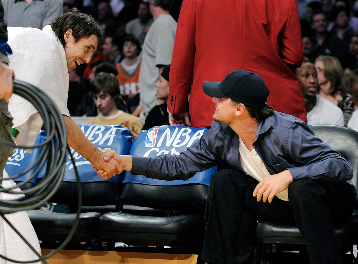 Leonardo Dicaprio shakes hands with Phoenix Suns guard Steve Nash during the Los Angeles Lakers game against the Suns at Staples Center in Los Angeles.