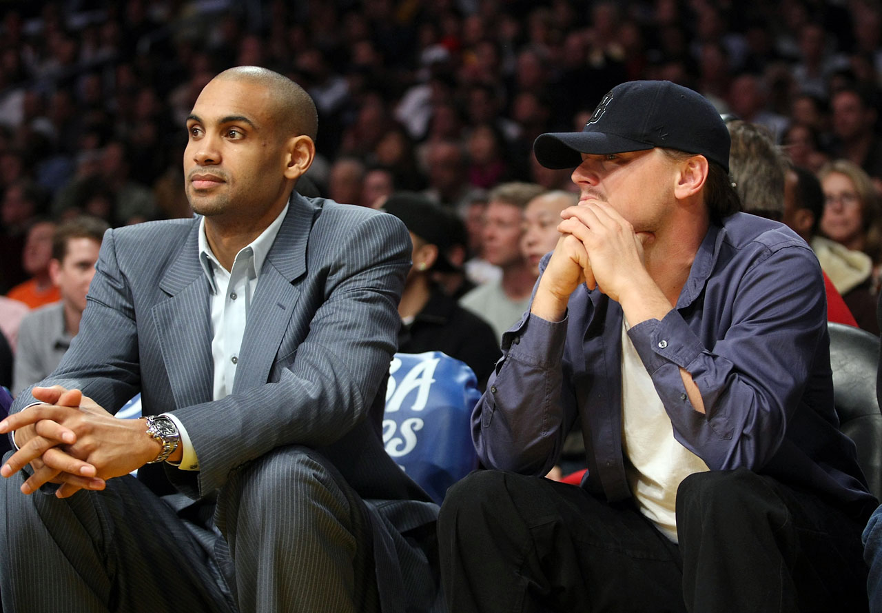 Leonardo Dicaprio sits with Phoenix Suns forward Grant Hill during the Los Angeles Lakers game against the Suns at Staples Center in Los Angeles.