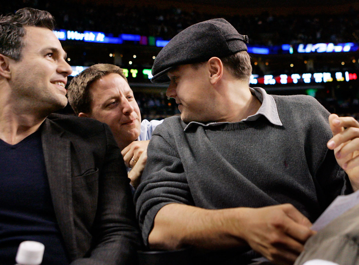 Leonardo DiCaprio chats with a fan alongside Mark Ruffalo (left) as they attend the Boston Celtics game against the Cleveland Cavaliers at TD Garden in Boston.