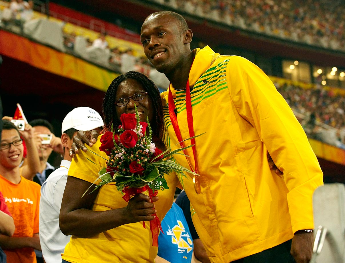 Usain Bolt poses with his mom, Jennifer, after winning the gold medal in the men's 100m final with a world record time of 9.69 during the 2008 Summer Olympics in Beijing, China.