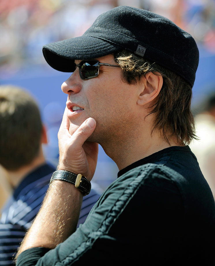 Jon Bon Jovi watches from the sideline as the New York Giants and Cincinnati Bengals warm up before their game at Giants Stadium in East Rutherford, NJ.