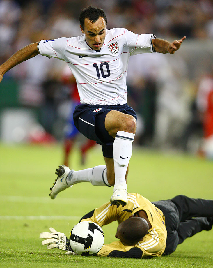 Landon Donovan clashes with the goalkeeper during a U.S. match with Cuba.
