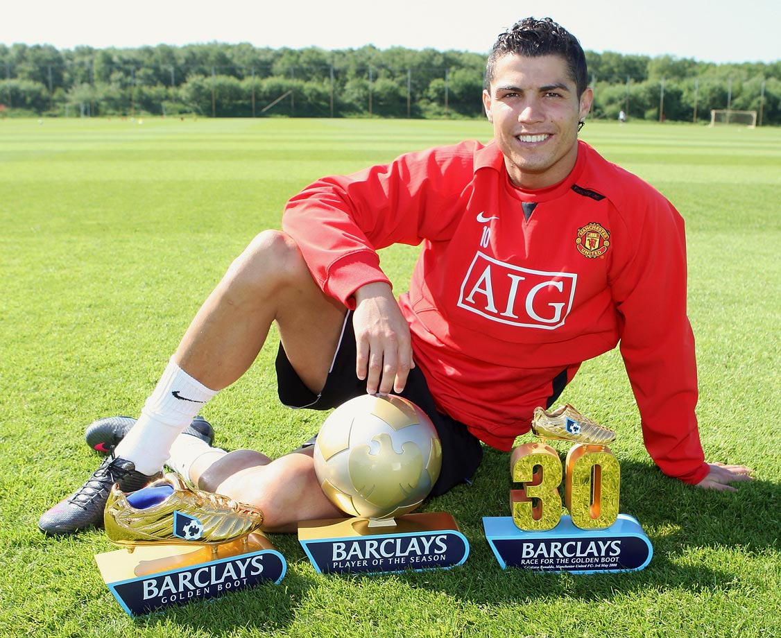 Cristiano Ronaldo with his Barclays Player of the Year, Golden Boot and 30 League Goals awards at Carrington Training Ground in Manchester, England.