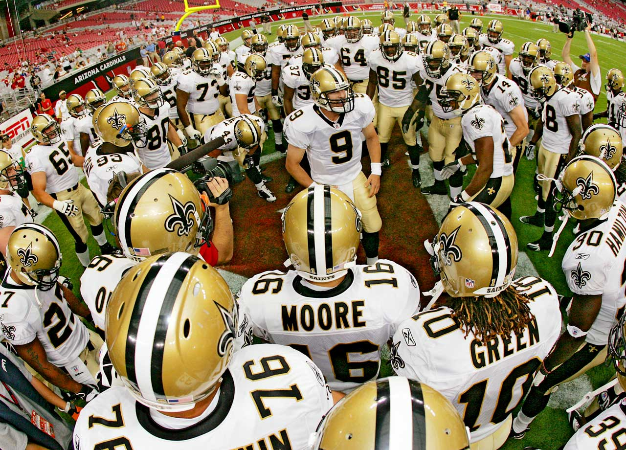 Drew Brees pumps up the Saints prior to a preseason matchup with the Cardinals. The quarterback has become known for his pregame chants, drawing from Marine Corps rituals and the movie 300 to motivate his teammates.
