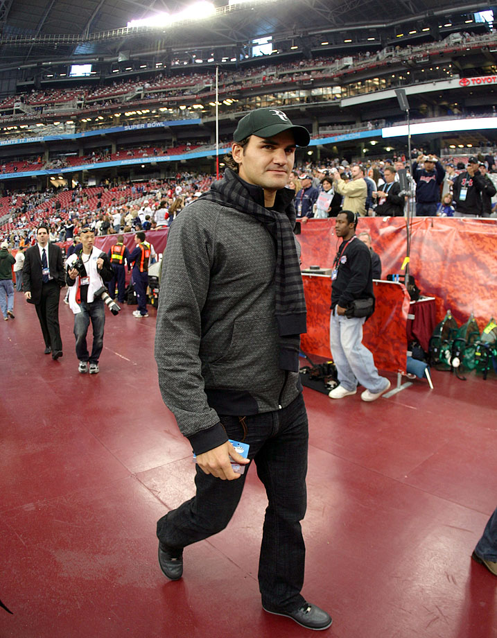 Roger Federer walks off the field before Super Bowl XLII between the New York Giants and the New England Patriots at the University of Phoenix Stadium in Glendale, Ariz., on Feb. 3, 2008.