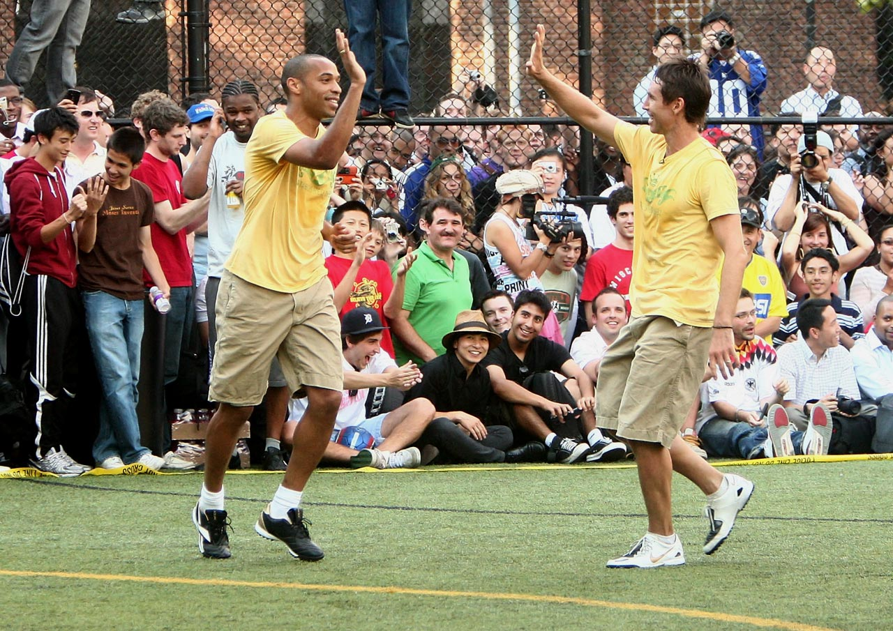 Nash celebrates with Thierry Henry during the Showdown in Chinatown celebrity soccer match in New York City. A multi-sport talent, Nash also put his soccer skills on display during the 2005 Slam Dunk contest, heading a pass to Amare Stoudemire to spark a spectacular jam.