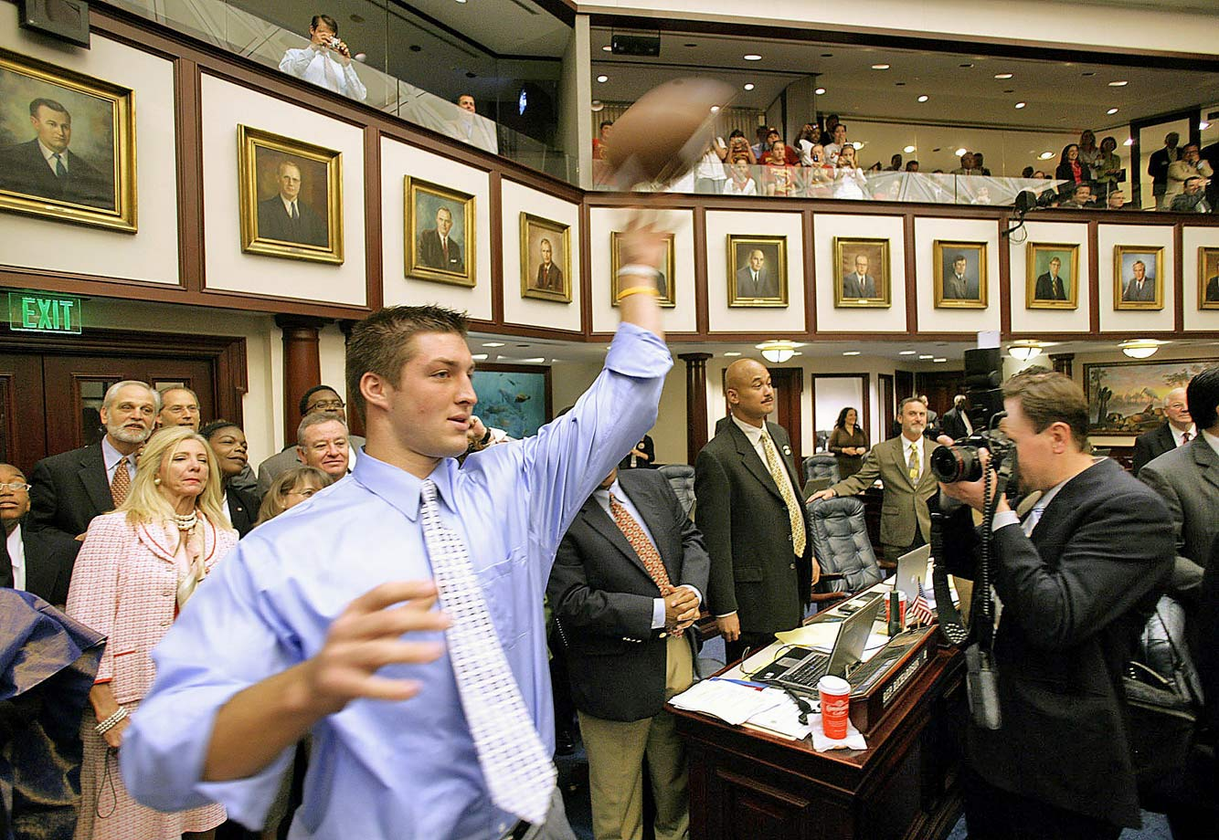 Tim Tebow throws a pass to Marco Rubio, Speaker of the Florida House of Represenatives, in the house chamber at the Capitol in Tallahassee, Fla. Tebow was honored at the Florida State Capitol after he won the Heisman trophy and was part of Florida's national championship team.