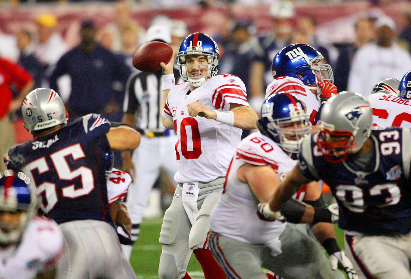 Eli Manning kept the Super Bowl trophy with the Manning family by helping the Giants knock off the previously undefeated New England Patriots.