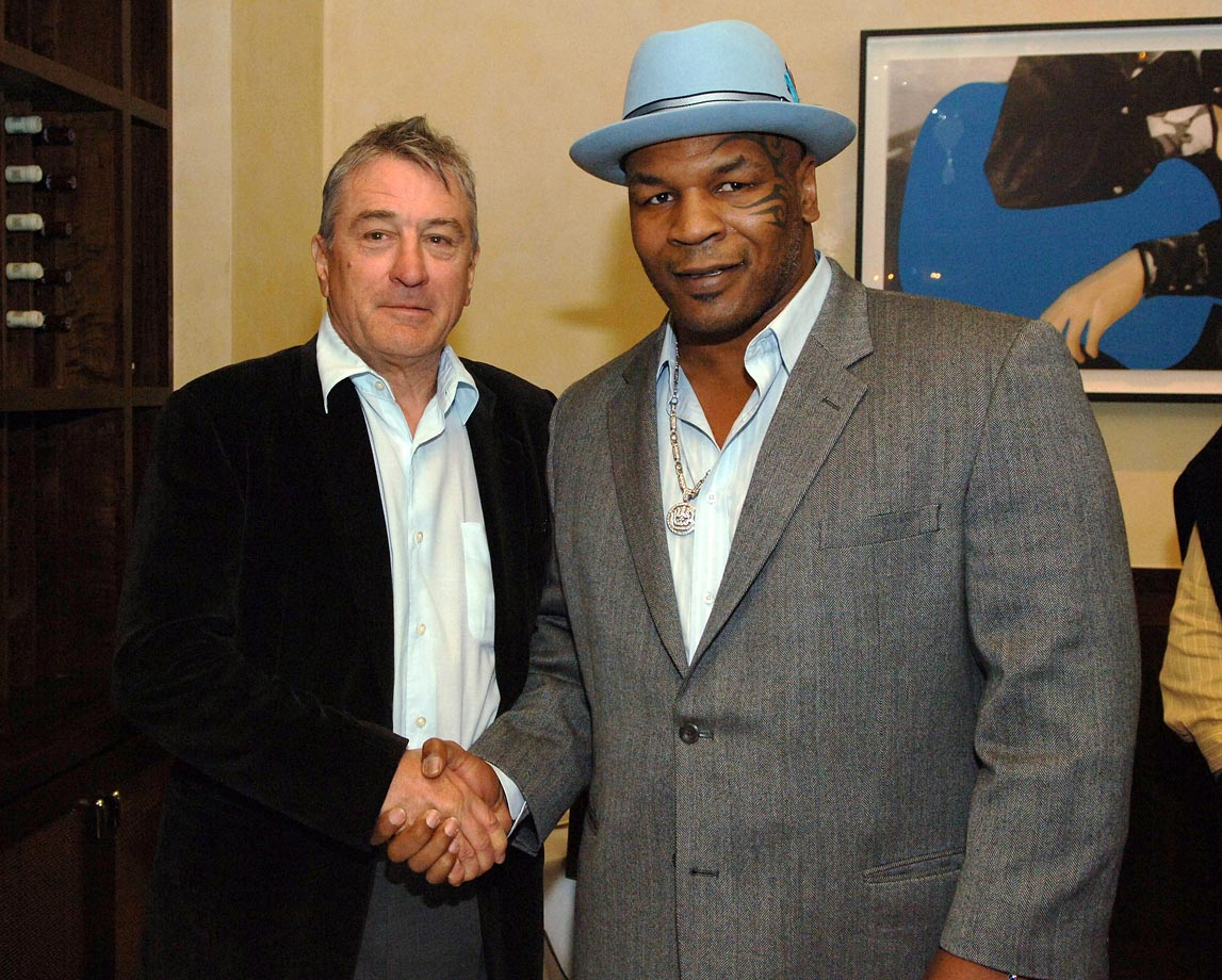 Robert De Niro and Mike Tyson pose together as they attend the AGO Grand Opening at Hard Rock Hotel & Casino in Las Vegas.