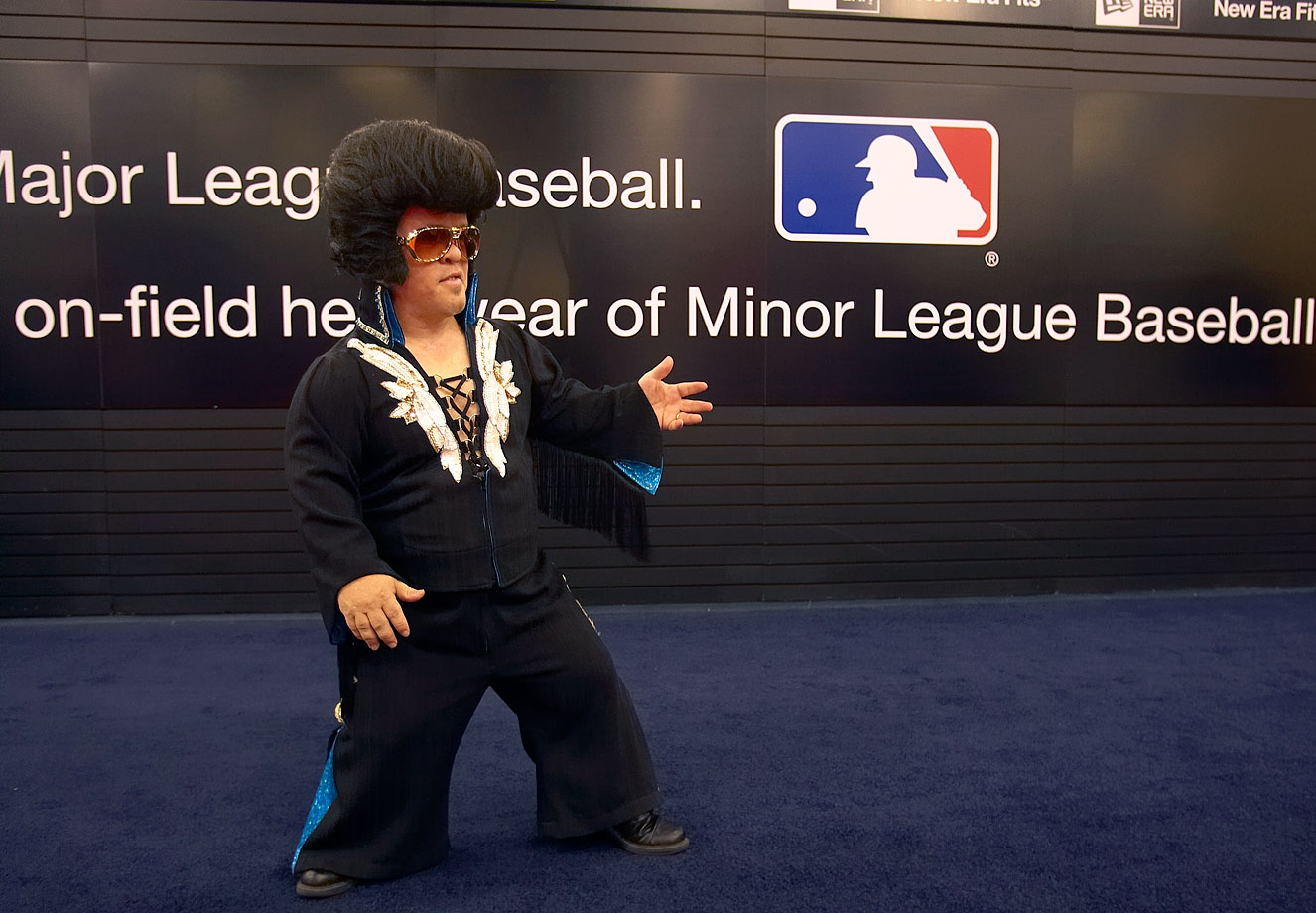 A mini Elvis impersonator attends the MLB Winter Meetings at the Bellagio Hotel in Las Vegas on Dec. 8, 2008.