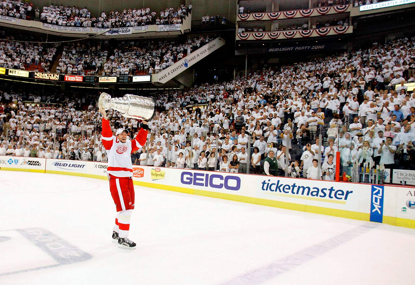 The superb Red Wings defenseman is the first European-born and trained player to captain a Stanley Cup champion. Here he skated with the chalice as the crowd in Pittsburgh looked on at the conclusion of Game 6.