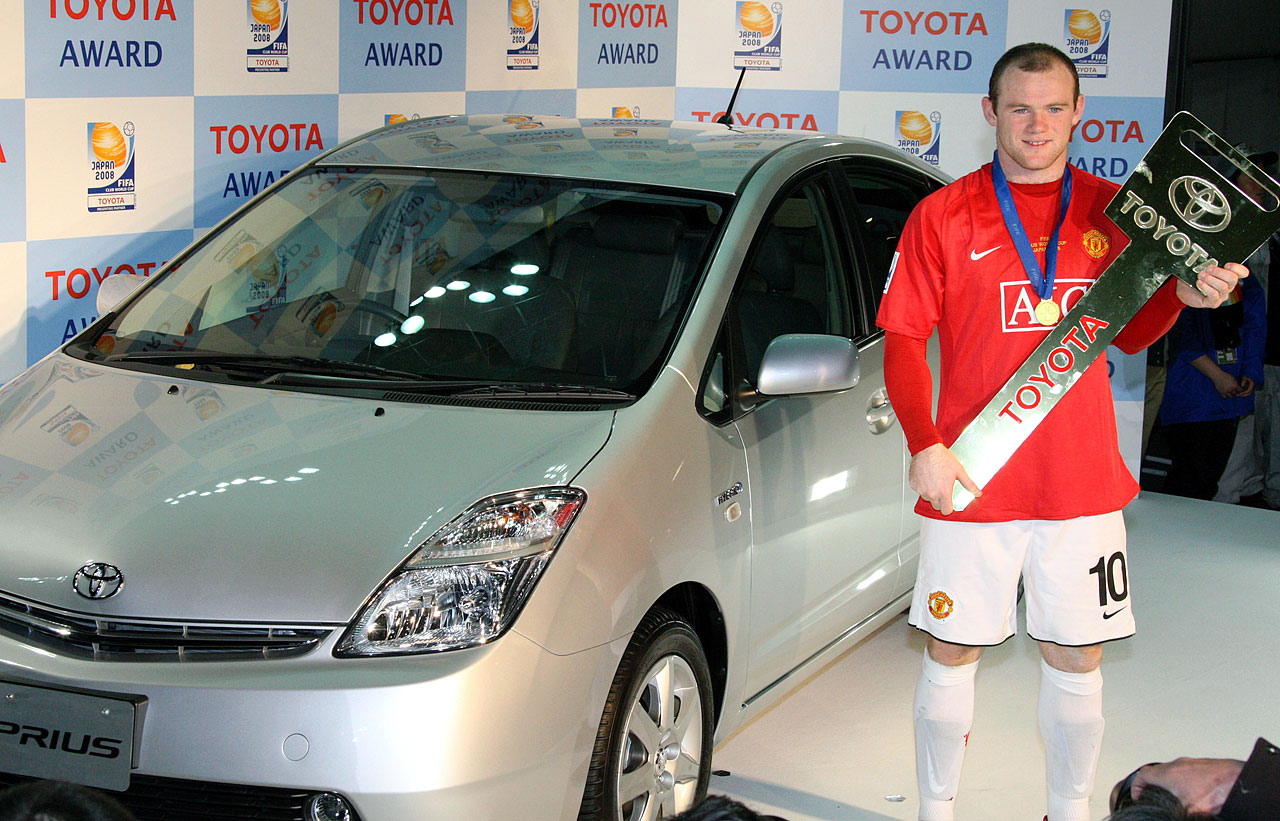 Rooney stands in front of a Toyota Prius as he won the MVP award and the hybrid car at the FIFA Club World Cup Soccer tournament in Yokohama near Tokyo on Dec. 21, 2008.