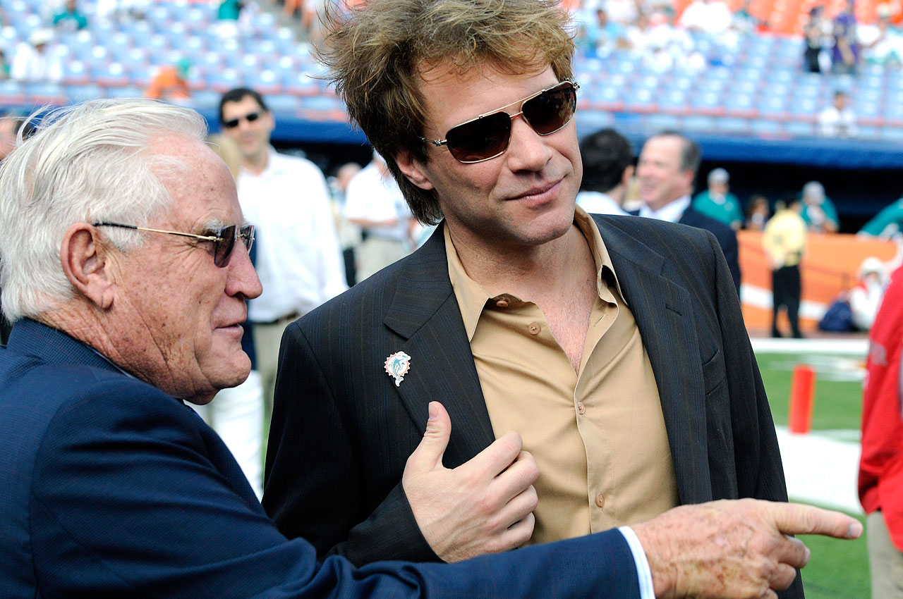 Don Shula and Jon Bon Jovi chat before the AFC Wild Card Playoff game between the Miami Dolphins and Baltimore Ravens at Dolphin Stadium in Miami.