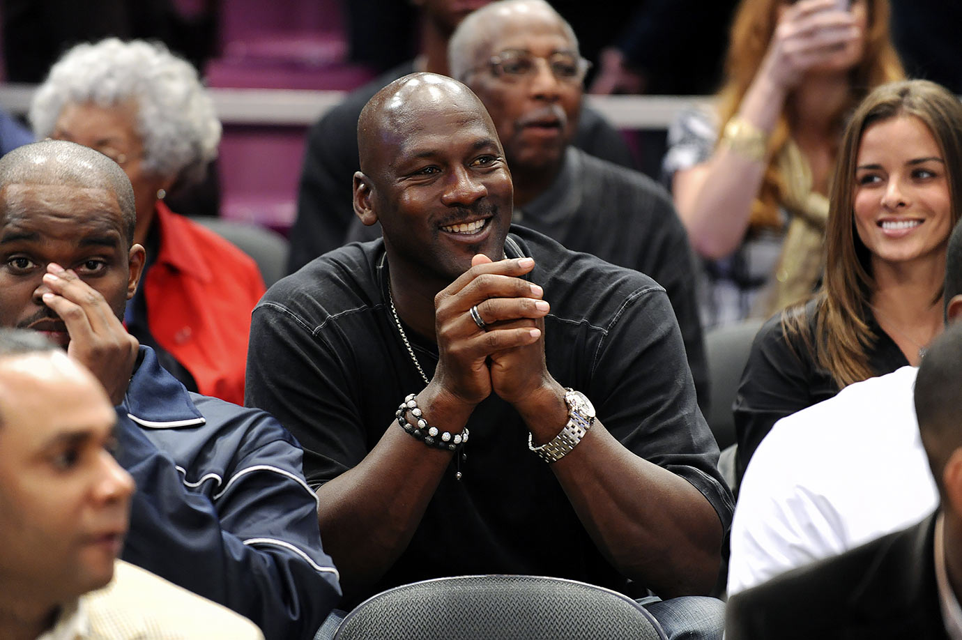 Michael Jordan smiles in the stands during the 2009 Jordan Brand Classic High School All-American Game at Madison Square Garden.