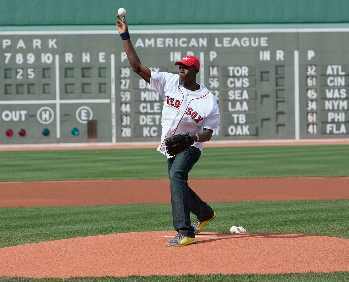 Bolt throws out the first pitch before a New York Yankees and Boston Red Sox game at Fenway Park in Boston.