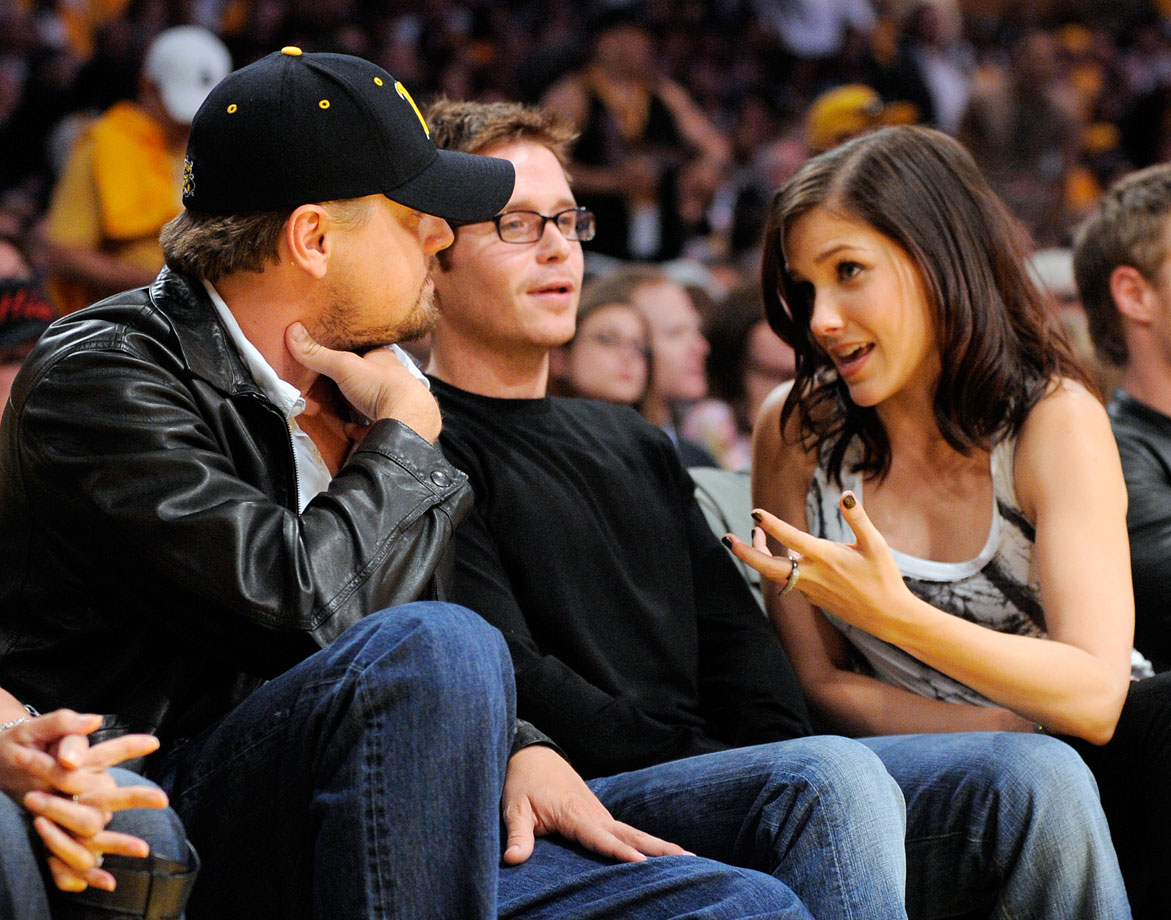 Leonardo DiCaprio, Kevin Connolly and Sophia Bush attend Game 1 of the NBA Finals between the Los Angeles Lakers and Orlando Magic at Staples Center in Los Angeles.