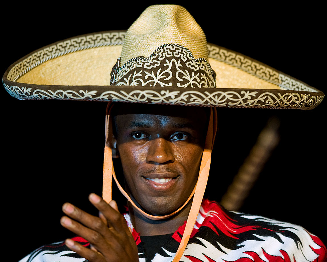 Usain Bolt sports a sombrero during a 2009 conference at the World Sport Congress in Mexico City.