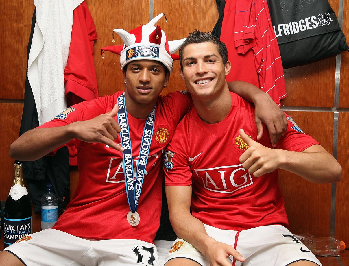 Cristiano Ronaldo and Nani celebrate in the dressing room after the Barclays Premier League match between Manchester United and Arsenal at Old Trafford in Manchester.