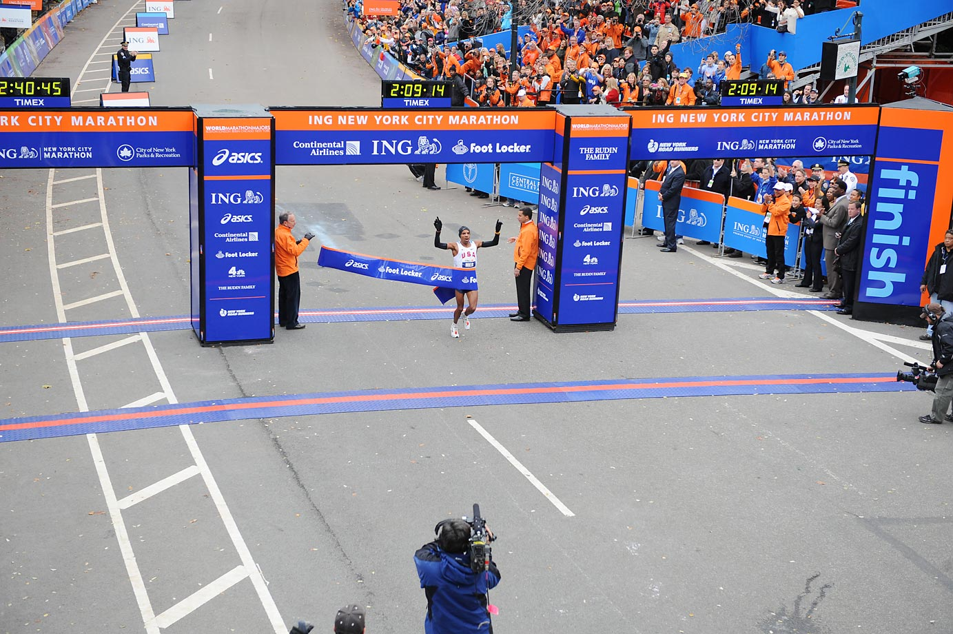 Meb Keflezighi of the U.S., crosses the finish line, becoming the first American to win the race since 1982.  His time was 02:09:15.