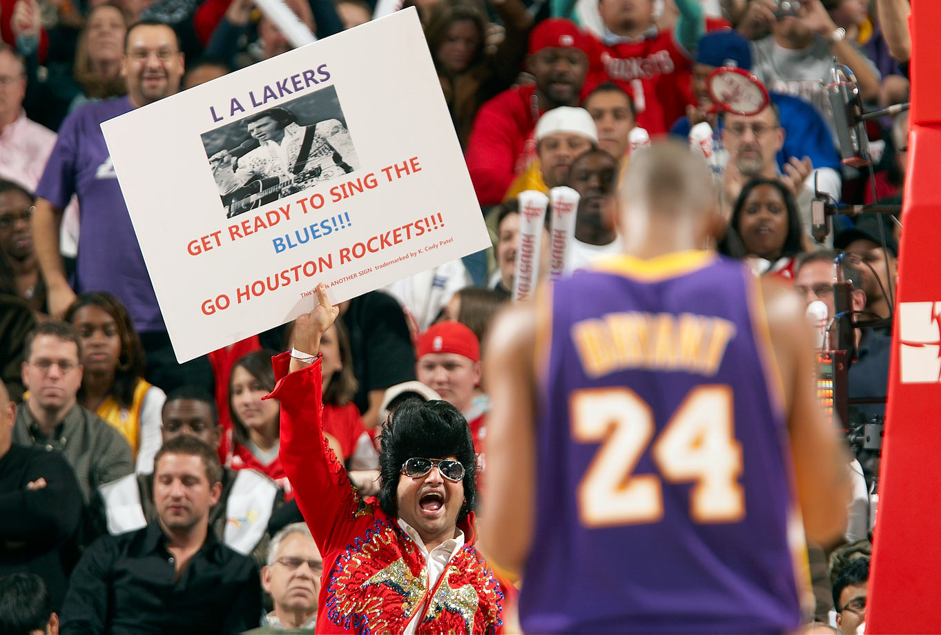 A Rockets and Elvis fan tries to distract Kobe Bryant during the Houston Rockets game against the Los Angeles Lakers at Toyota Center in Houston on Jan. 13, 2009.