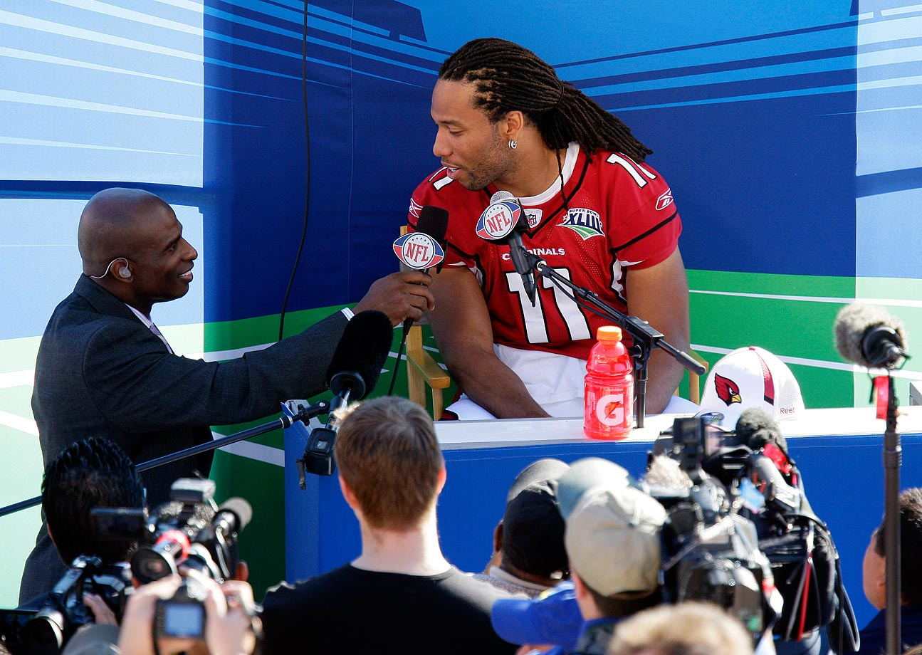 TV analyst Deion Sanders interviews Cardinals wide receiver Larry Fitzgerald during Media Day for Super Bowl XLIII.