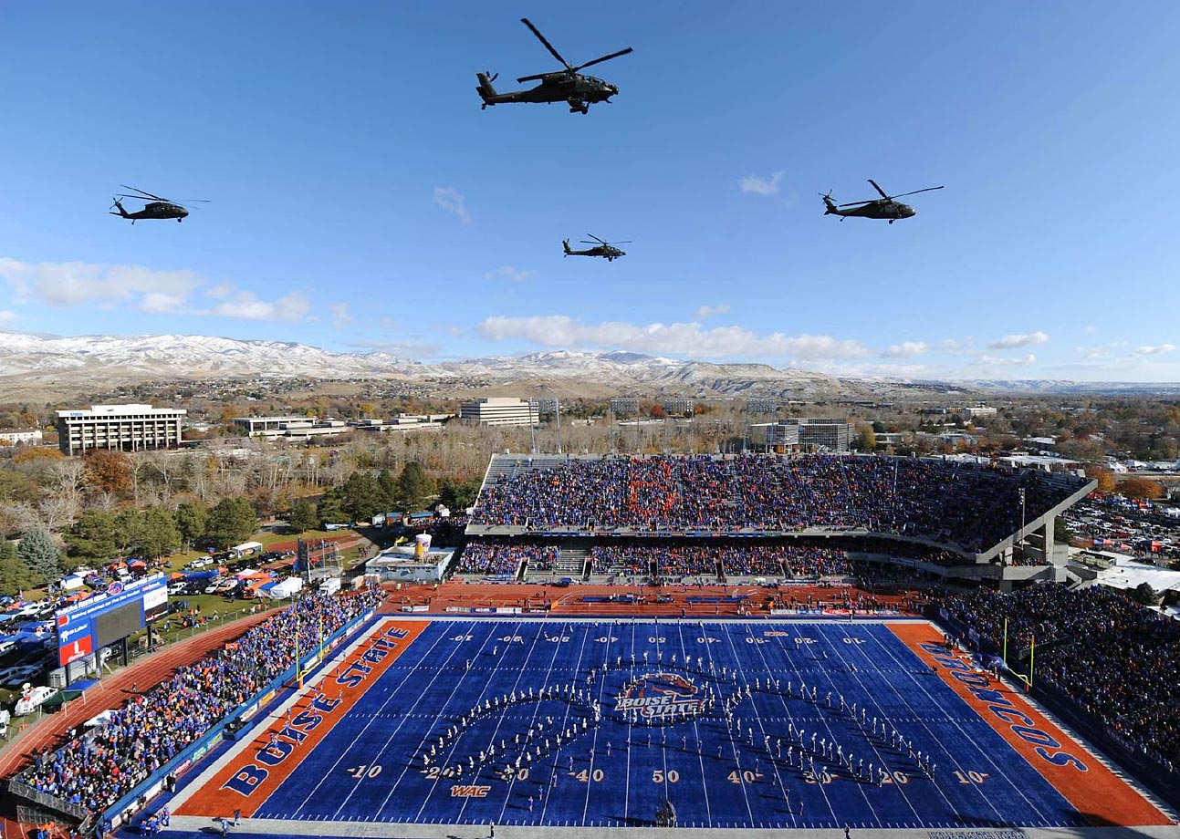 Apache and Blackhawk helicopters from the Idaho National Guard perform a flyover prior to the Idaho Vandals-Boise State Broncos game on Nov. 14, 2009.