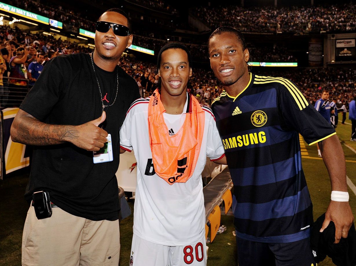 'Melo's got love for footballers. Especially when they come to his hometown of Baltimore. He got to meet Brazilian star Ronaldinho and Chelsea's Didier Drogba during a World Football Challenge in 2009.
