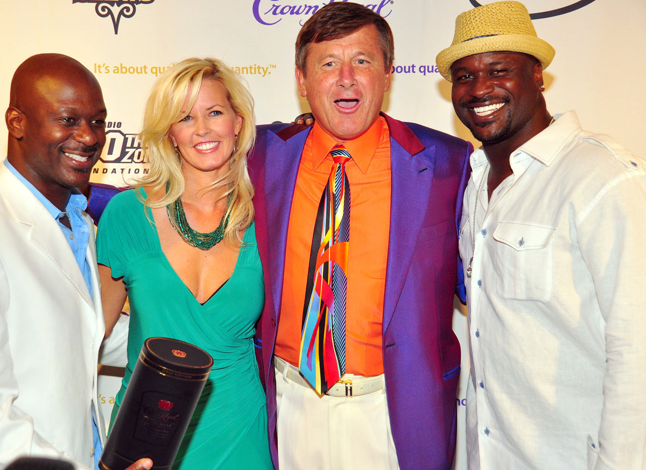 Craig Sager and his wife Stacy pose with Doug and Ryan Stewart at the Stewpendous Awards post-party on July 11, 2009 at the W Hotel in Atlanta.