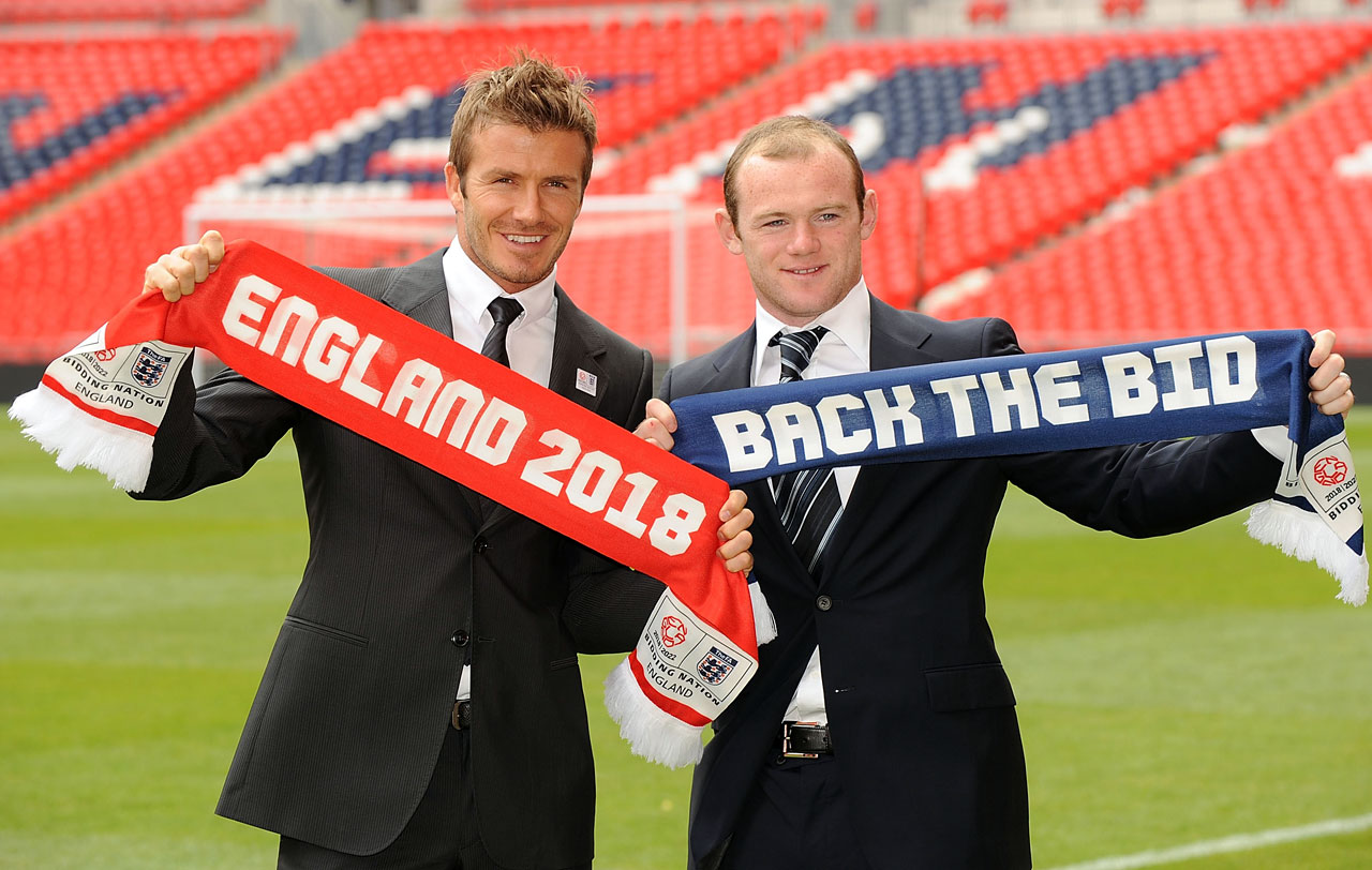 Beckham Rooney smile as they pose for the cameras with scarves to show their support for the England 2018 - 2022 World Cup Bid at Wembley Stadium on May 18, 2009 in London.