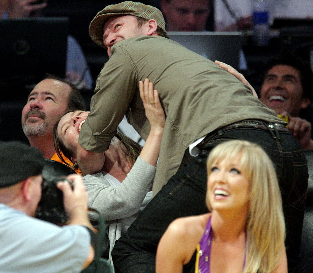 Justin Timberlake playfully jumps on Jessica Biel while on the ''Kiss Cam'' during a Lakers game at Staples Center in Los Angeles on April 21, 2009.
