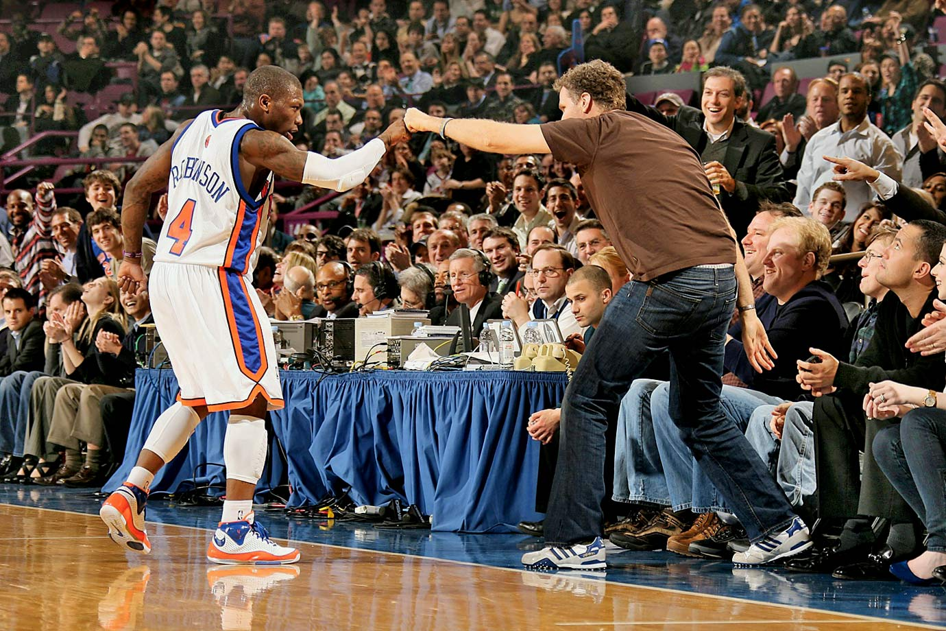 "Nate Robinson and Will Ferrell do a little ""Shake and Bake"" during the New York Knicks game against the Indiana Pacers on Feb. 23, 2009 at Madison Square Garden in New York City."