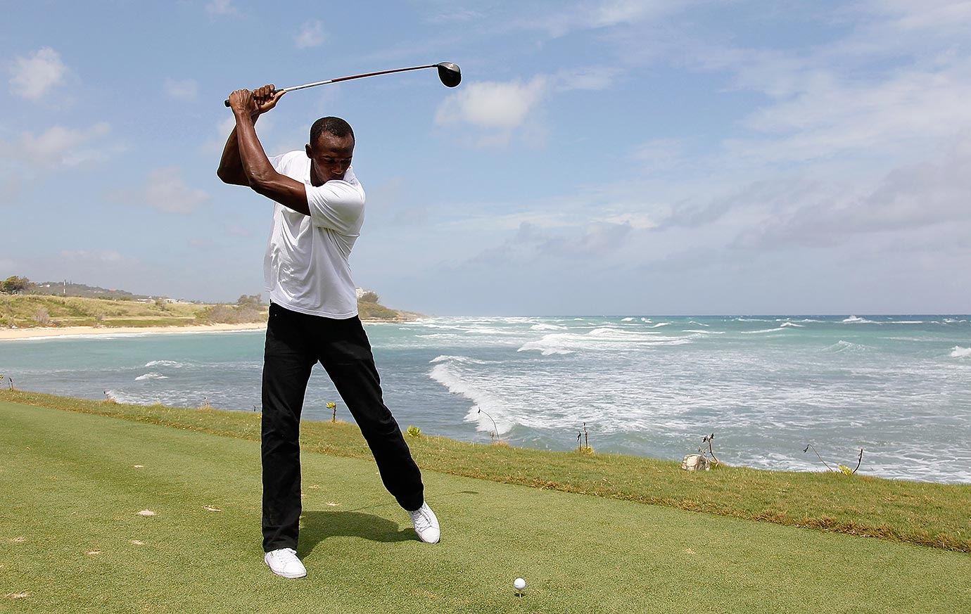 Bolt goofs off by teeing off into the Caribbean Sea during the quarterfinal matches of The Mojo 6 Jamaica LPGA Invitational in Montego Bay.