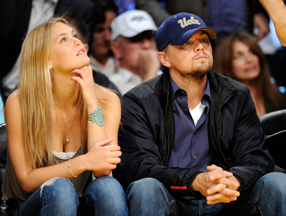 Leonardo DiCaprio and Bar Refaeli attend Game 5 of the Western Conference Quarterfinals between the Los Angeles Lakers and Oklahoma City Thunder at Staples Center in Los Angeles.