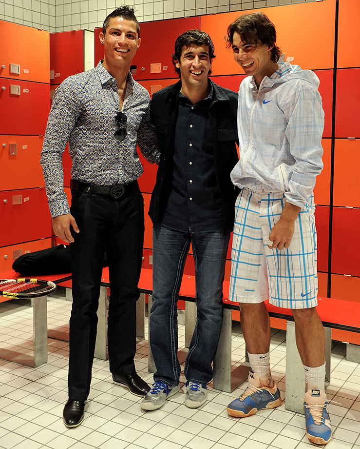 Cristiano Ronaldo and Raul Gonzalez pose with Rafael Nadal at the Madrid Open tennis tournament.