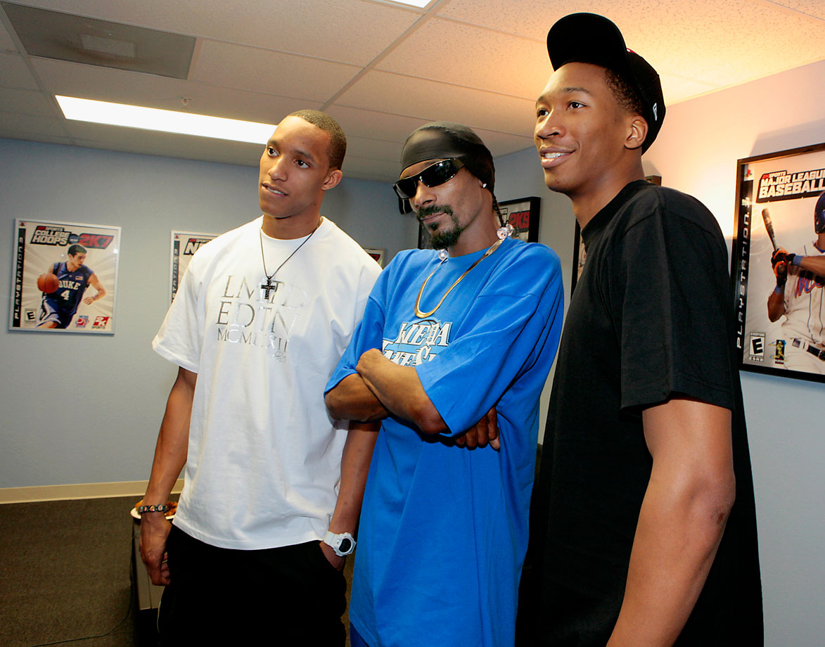 Evan Turner, Snoop Dogg and Wesley Johnson pose together during a visit to 2K Sports motion capture studios for the upcoming video game NBA 2K11 on June 7, 2010 in Novato, Calif.