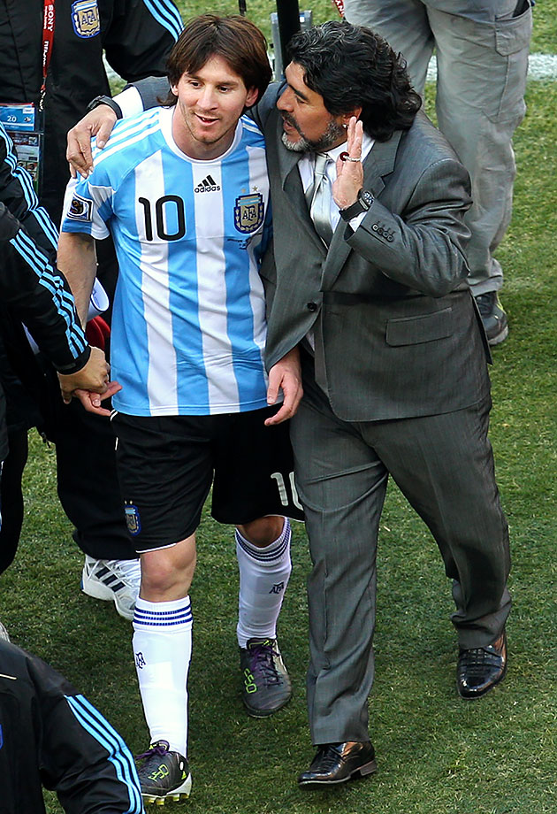 Argentina head coach Diego Maradona talks with Lionel Messi as they celebrate their victory over South Korea in the FIFA World Cup Group B match on June 17, 2010 at Soccer City Stadium in Johannesburg, South Africa.