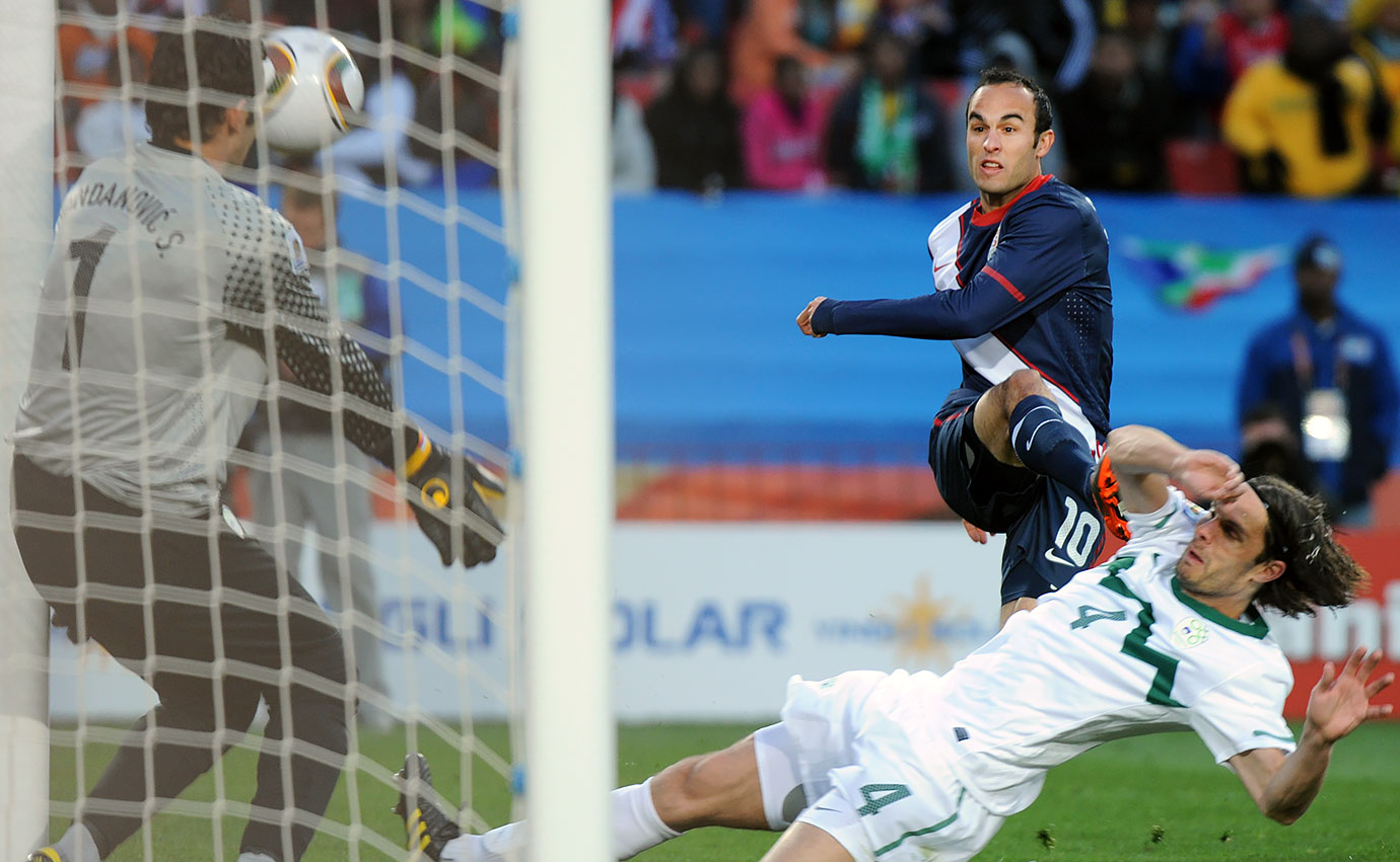 Landon Donovan shoots and scores past Slovenia's goalkeeper Samir Handanovic and defender Marko Suler during their Group C first-round match at the 2010 World Cup.