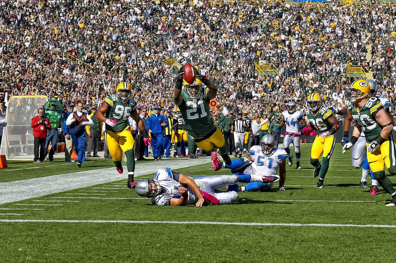 Packers cornerback Charles Woodson returns an interception 48 yards for a touchdown against the Lions at Lambeau Field.