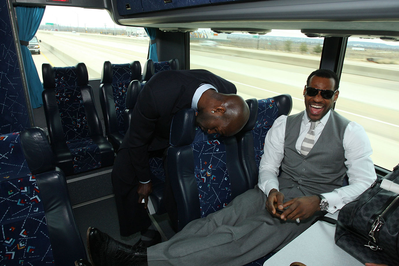 Kevin Garnett and LeBron James share a laugh on the bus ride to the stadium prior to the 2010 NBA All-Star game in Dallas.