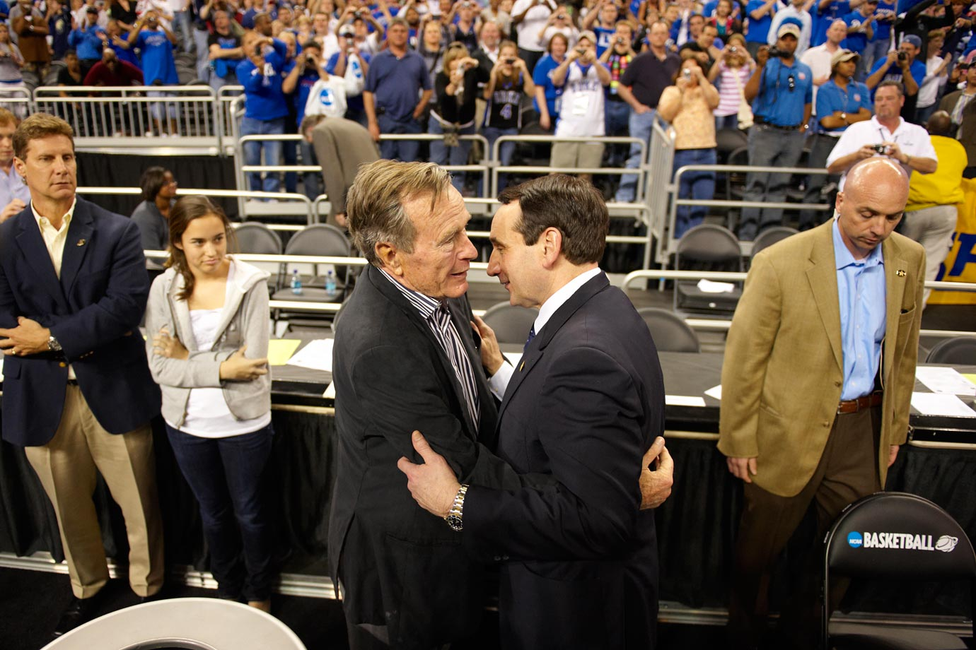 Former President George H.W. Bush congratulates Mike Krzyzewski after Duke defeated Baylor, 61-59, in the 2010 South Regional Finals.