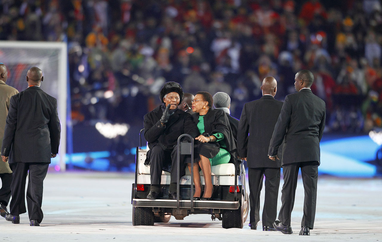 Mandela is driven onto the field during World Cup festivities with his third wife, Graca Machel.