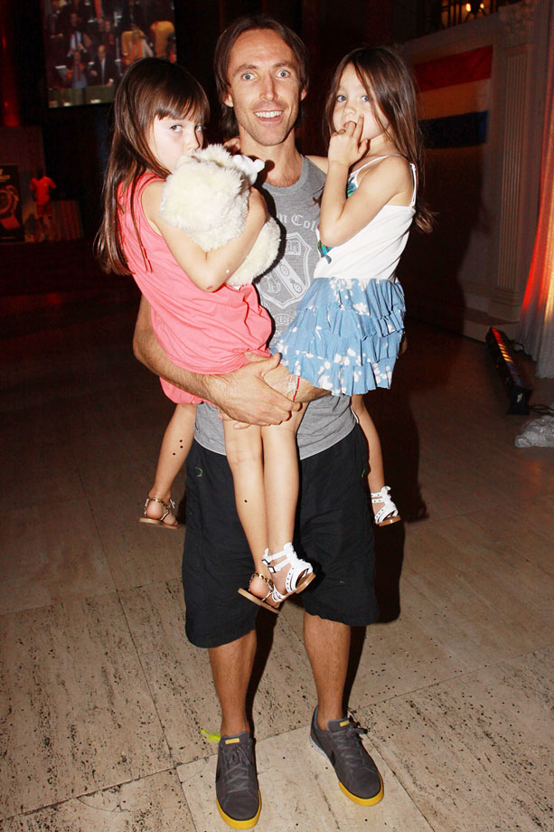 Holding his twin daughters Lola and Bella, Nash takes a picture after the World Cup Final. The girls were born on Oct. 14, 2004.
