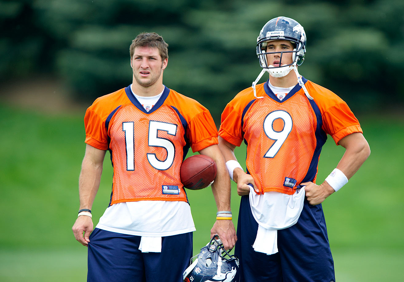 Tim Tebow and Brady Quinn look on during a minicamp workout in Denver. Tebow played just six games during his rookie season, mostly as a backup before starting the last three games of the Broncos' season. He threw for a total of 654 yards, five touchdowns and three interceptions. He also rushed for 227 yards and six touchdowns.