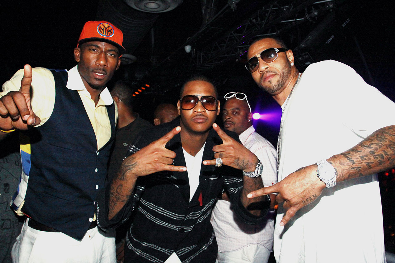 Pre-wedding festivities at Amnesia in New York City with Amar'e and Kenyon Martin. Pretty sure Amar'e is flashing a ''No. 1'' sign, but it's unclear what Carmelo and Martin are doing.