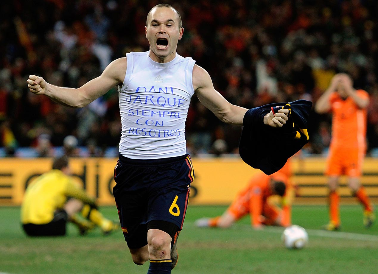 A joyous Andres Iniesta celebrates his decisive goal.                               (Shot with Canon EOS-1D Mark III)