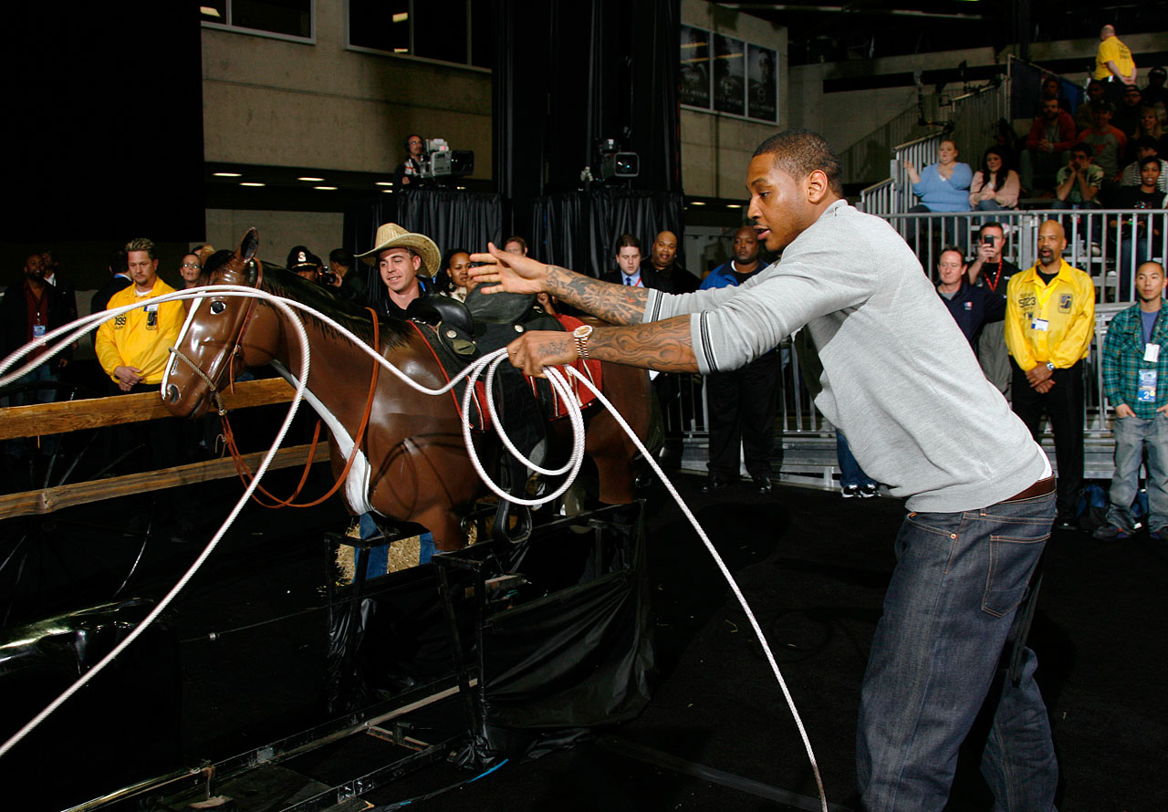 Here's Carmelo roping a fake calf. Why? Because that's what people were doing at the 2010 All-Star Celebrity Game in Dallas.