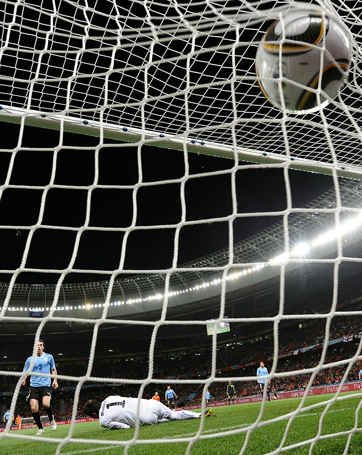 The ball hits the back of Uruguayan goalkeeper Fernando Muslera's goal after Giovanni van Bronckhorst's 40-yard bullet of a goal in the 2010 World Cup semifinal between the Netherlands and Uruguay.