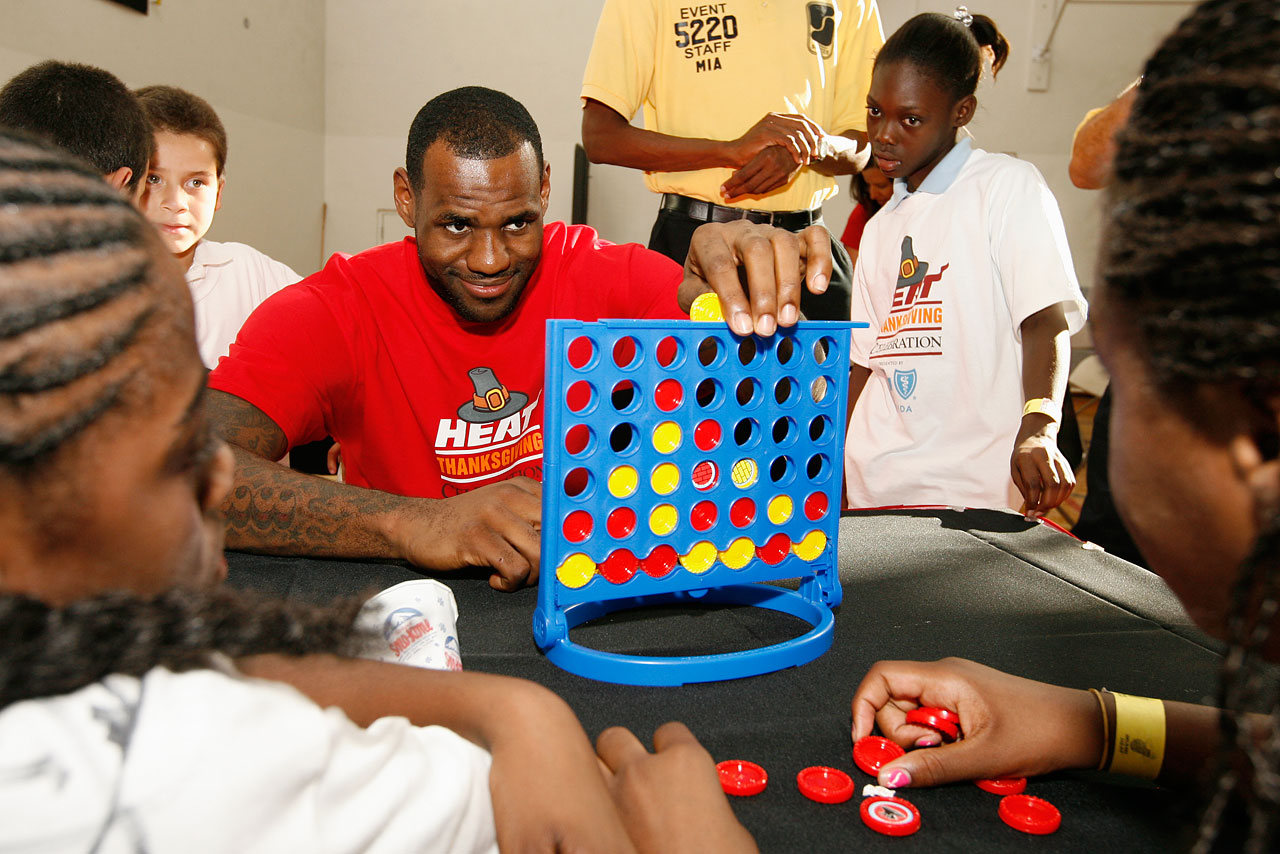 Regardless of the ill will, James still makes time for his fans. In this photo, The King plays Connect Four with children from the Miami Rescue Mission in 2010.
