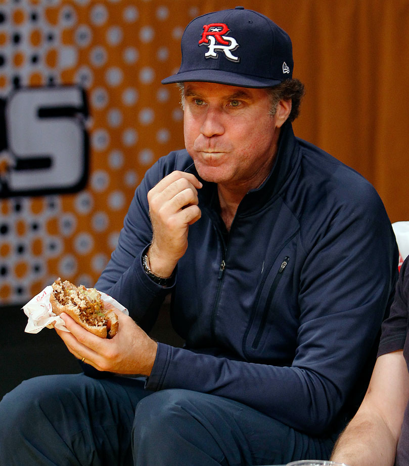 Will Ferrell eats a burger during the Los Angeles Lakers game against the Phoenix Suns on Nov. 14, 2010 at Staples Center in Los Angeles.